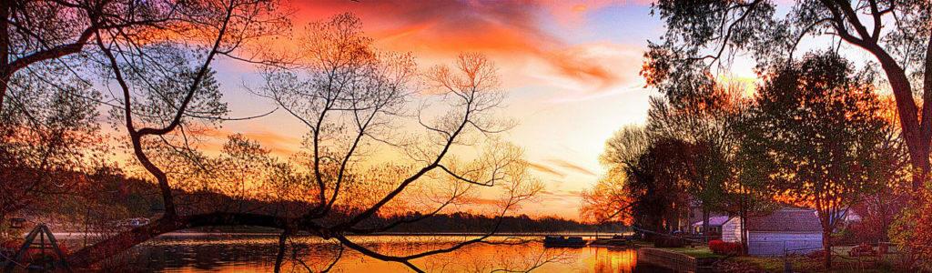 trees-sunset-and-lake-reflection-landscape-web-header